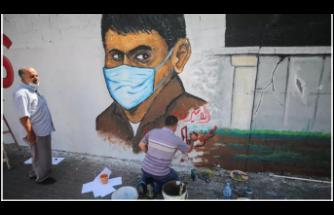 Gazze'de ressamlar hapishaneden kaçan Filistinlileri resmetti
